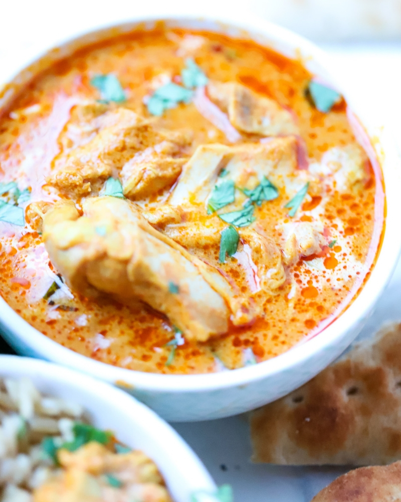 Instant Pot Butter chicken in a bowl with garnish