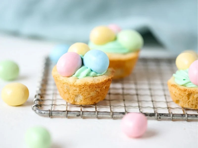 Three Easter Cookie Cups with candy on top.