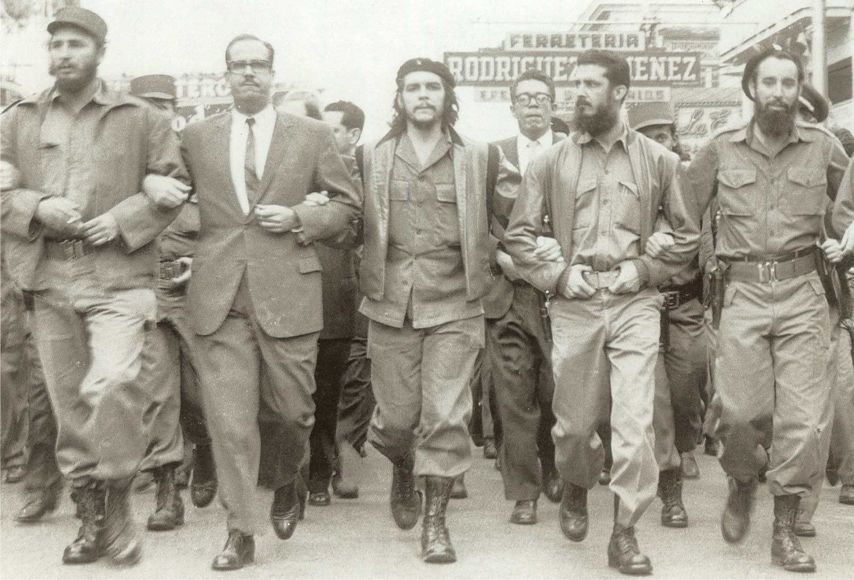 Castro (far left), Che Guevara (center), and other leading revolutionaries, marching through the streets in protest at the La Coubre explosion, March 5, 1960