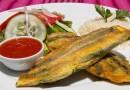 Plato de la gastronomia guatemalteca, contiene ejotes envueltos, ensalada verde, arroz, salsa roja,