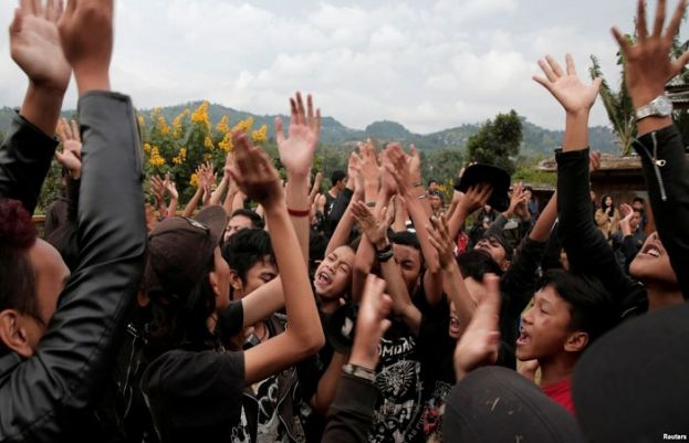 Punk community members dance during a punk music festival in Bandung, Indonesia West Java province, March 23, 2017.