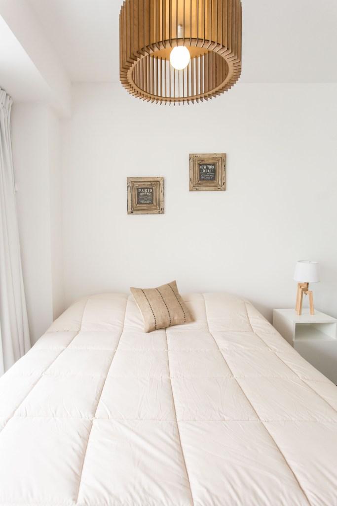 Apartemento amoblado con balcon superior cama frente