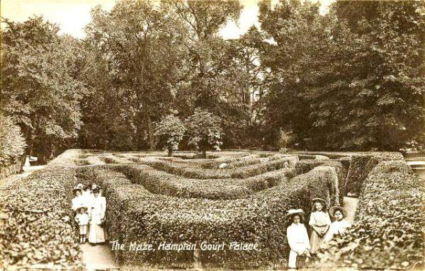 Hampton Court Palace,Early 20th century,An early postcard showing visitors posing in the Maze at Hampton Court Palace