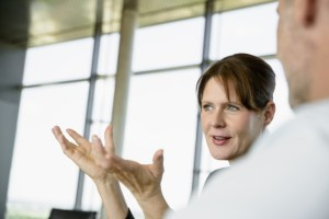 mature businesswoman gesticulates in discussion