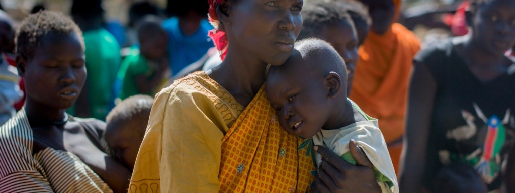 South Sudan women carrying child [Photo by unknown]