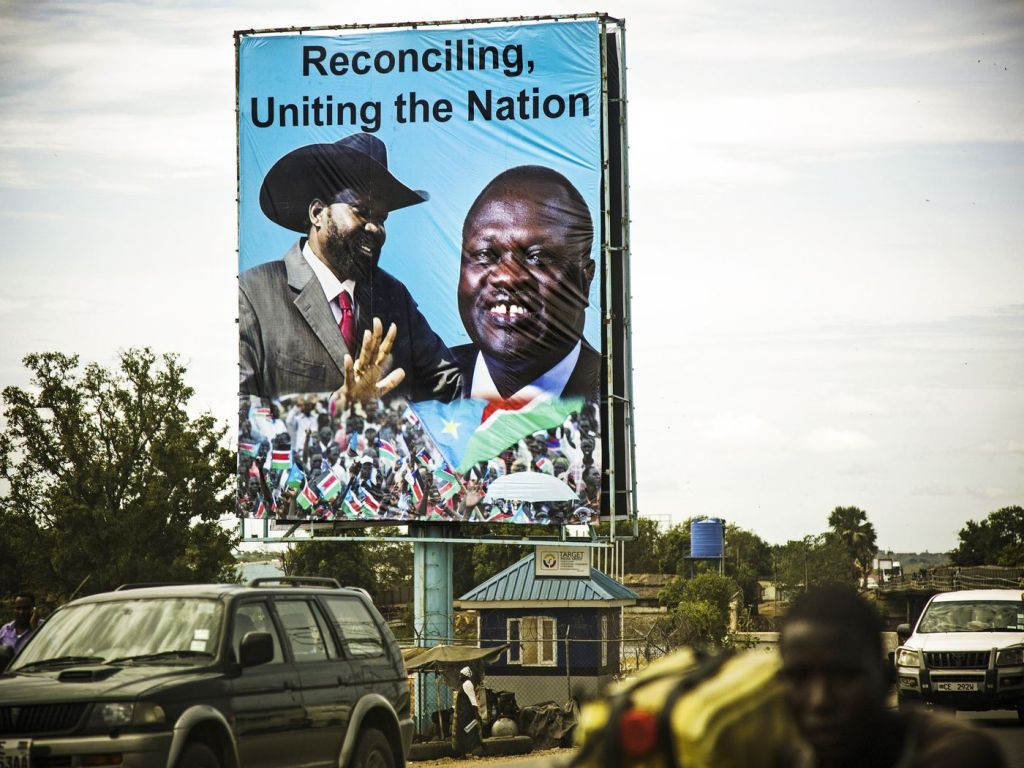 A billboard in Juba featuring South Sudan's President Salva Kiir (left) and rebel leader Riek Machar (right) on April 14, 2016 [Photo by AFP & Getty Images]