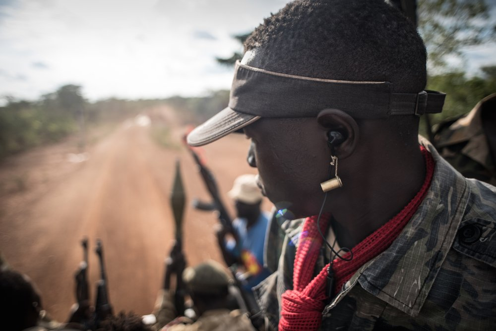 SPLA-IO soldiers ride on the back of a pick up truck through a rebel-held part of South Sudan's Kajo Keji county [Photo by Jason Patinkin/IRIN]