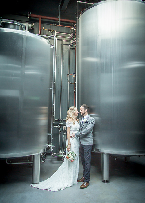 bride and groom in brewery