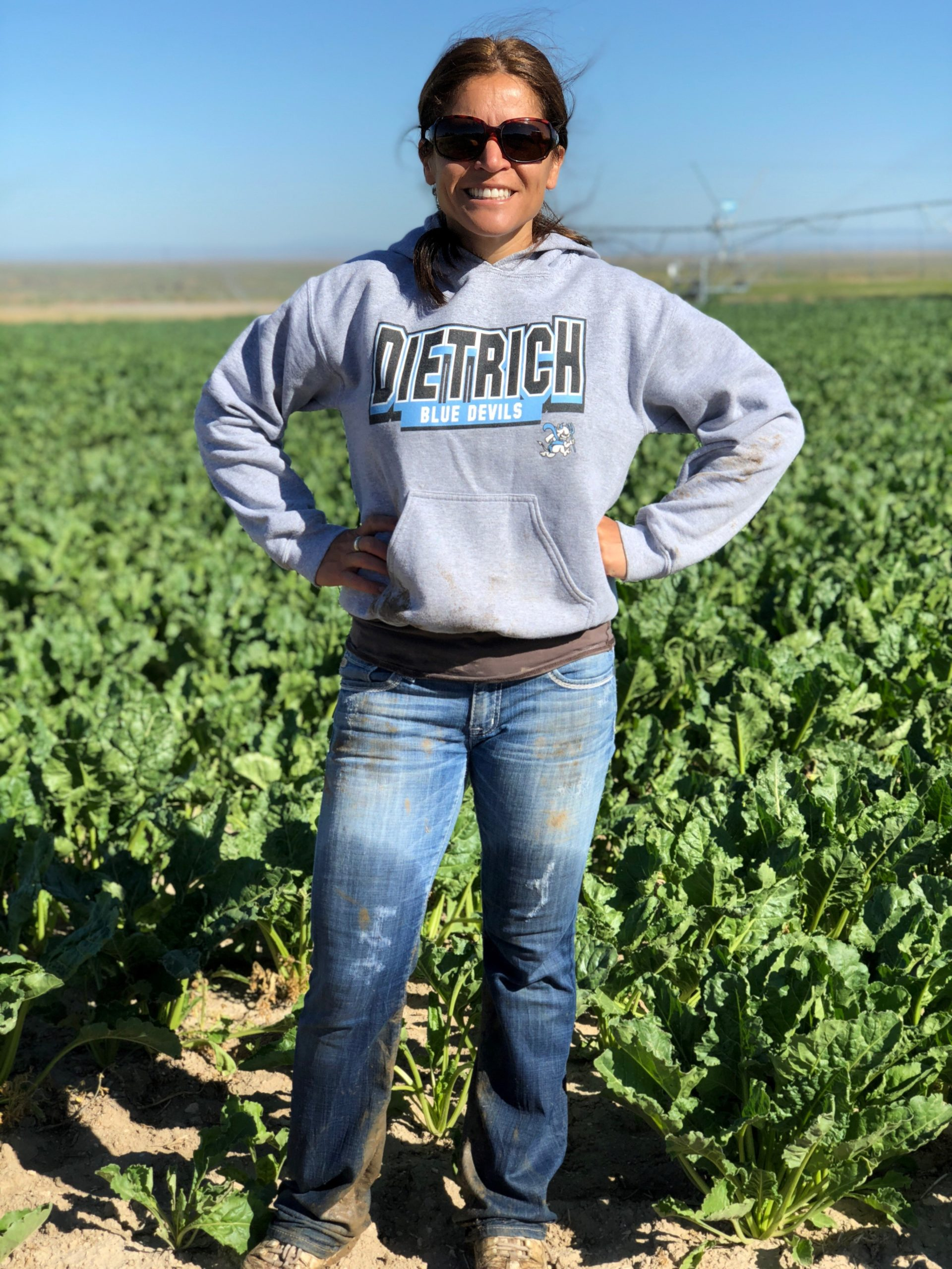 Mindy after helping the kids move their hand lines (irrigation) in their beet shares.
