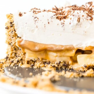 Banoffee Pie is a classic English dessert made with a graham cracker or biscuit crust and loaded with slices of banana, a silky layer of toffee caramel, and athick layer of freshly whipped cream.
