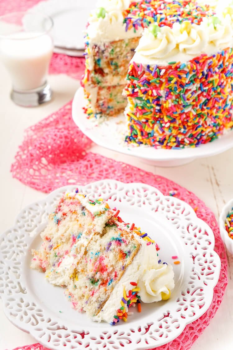 This Funfetti Birthday Cake is made with a fluffy white cake loaded with rainbow sprinkles and wrapped in a white chocolate whipped cream frosting and even more sprinkles!