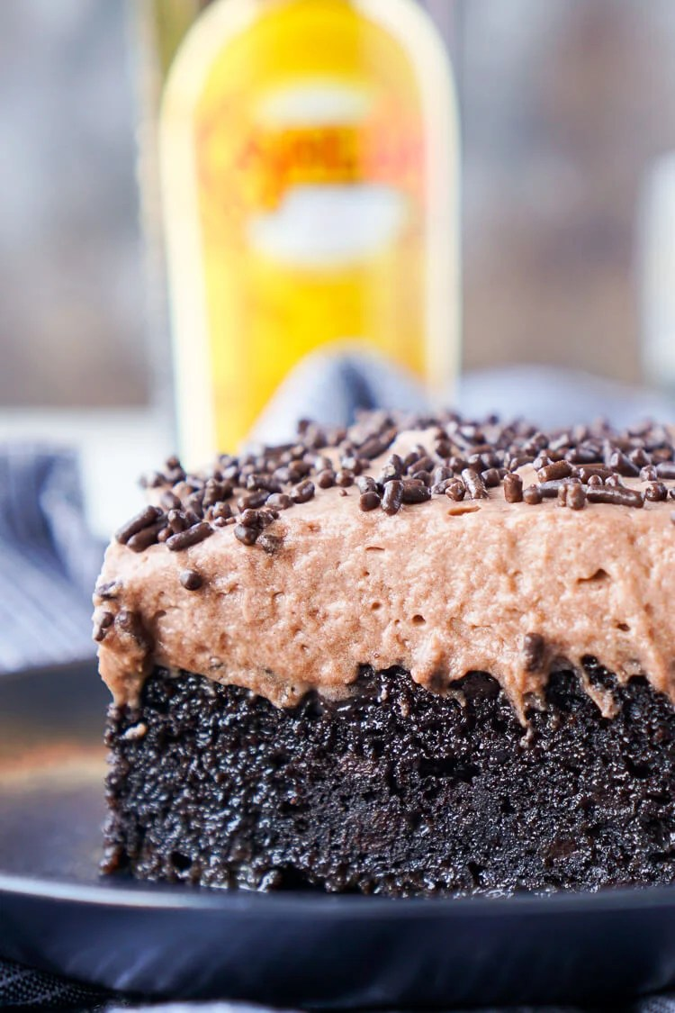 This Kahlua Chocolate Poke Cake is a deliciously boozy dessert that will get any party started!
