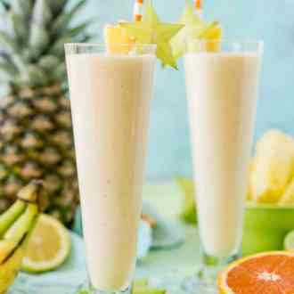 Tropical Smoothie is a delicious way to get in some vitamin C, protein, and potassium for breakfast or as an afternoon snack! It's loaded with orange juice, lime juice, lemon juice, banana, pineapple, and coconut extract for an extra fruity tropical flavor!