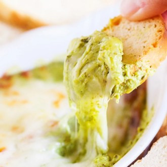 This Baked Spinach Artichoke Dip is a must have at any party. With two different prep methods, you can make it either hearty or creamy!