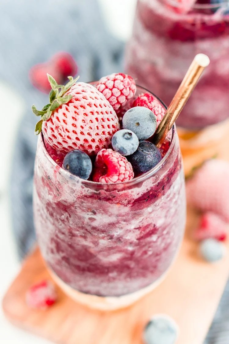 Sangria Slushies are loaded with berry and citrus flavors and Red Moscato making it the perfect frozen cocktail for summer!