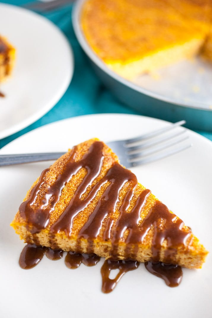 A light and fluffy Japanese-style pumpkin cheesecake recipe topped with a rich cinnamon and nutmeg infused caramel sauce. The perfect easy fall dessert!
