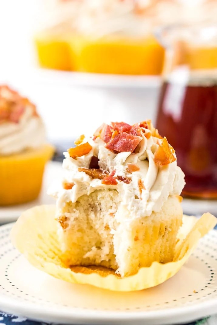 Maple Bacon Cupcakes with bite taken out of it.