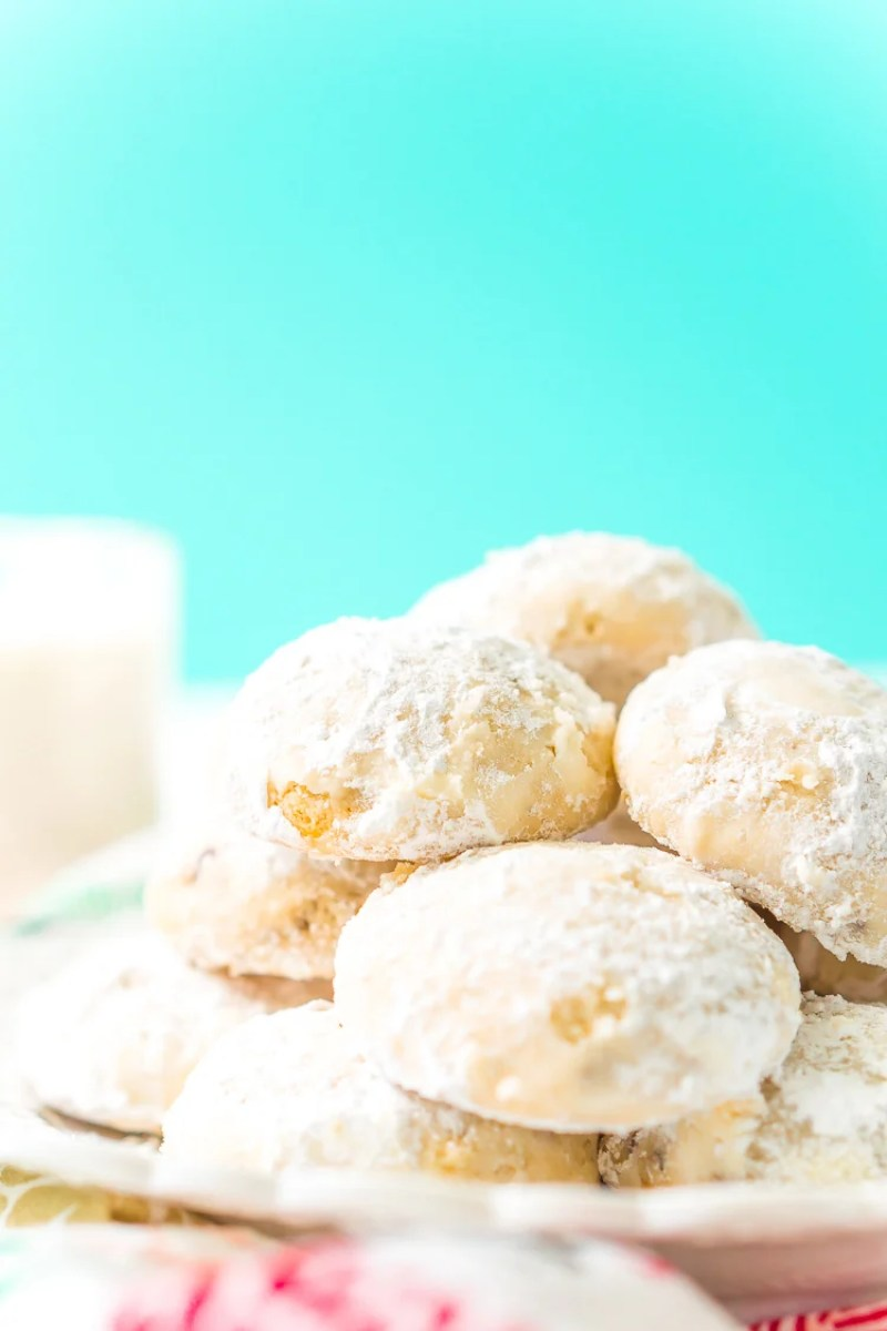 Snowball Cookies are a classic and a staple at holiday cookie exchanges. Made with butter, flour, sugar, vanilla, and chopped pecans, they're a delicious and addictive dessert!