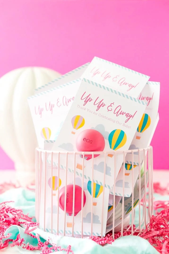 These Baby Shower Favors are a Free Printable perfect for any travel themed baby shower. These Party Favors were designed to fit EOS lip balms.