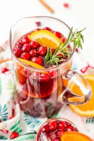 This Christmas Sangria is made with red wine, fruit juices, brandy, soda, and fruit for a delicious big-batch cocktail that's perfect for parties.