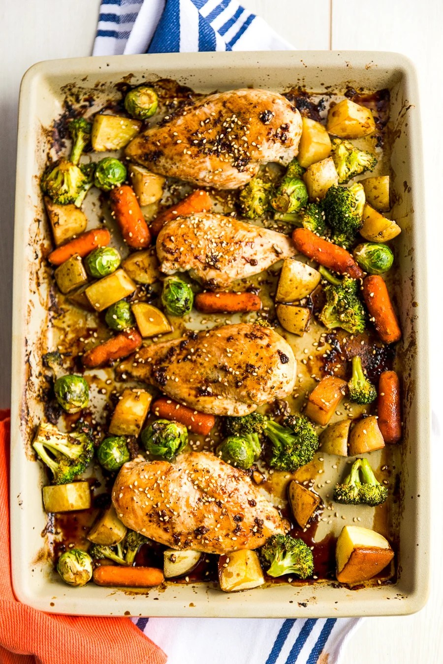 This Honey Ginger Chicken Sheet Pan Dinner is an easy Asian-inspired dish made with a tangy homemade sauce. You only need one pan to make it, so cleanup is a breeze!