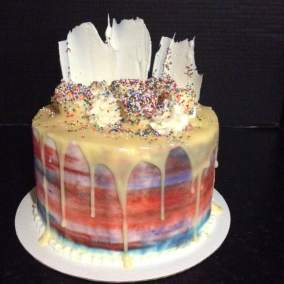 A new red white and blue drip cake