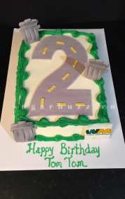 A garbage truck number 2 cake