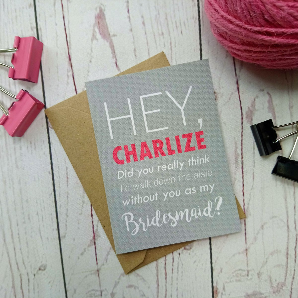 Grey background with white and pink writing. Miniature Boy Meets Girl Bridesmaid Request Card