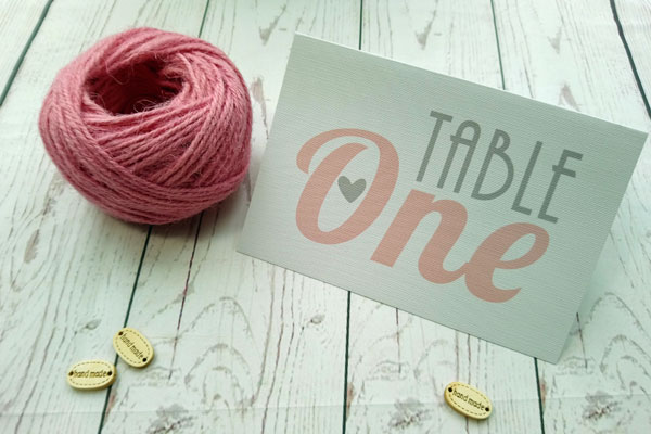 Vintage Birds Table Number in grey and pink next to pink twine
