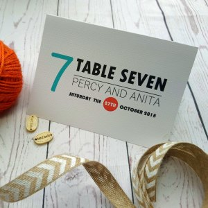 Lovers Tie The Knot Table Number Folded up in orange and blue