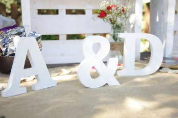 White wooden Bride and Groom initials to be used as wedding decoration at the venue or reception