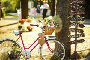 Bike Parked on Wedding Venue. Budget Wedding ideas on a wood direction stick