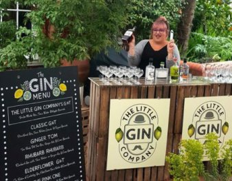 Gin bar with lady serving gin