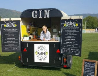 gin trailer with lady serving gin