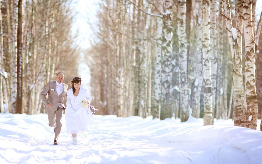 Bride and groom getting married in snow