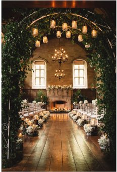 wedding arch set indoors with floating candles