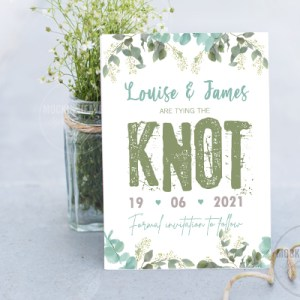 save the date card with blue leave watercolour design