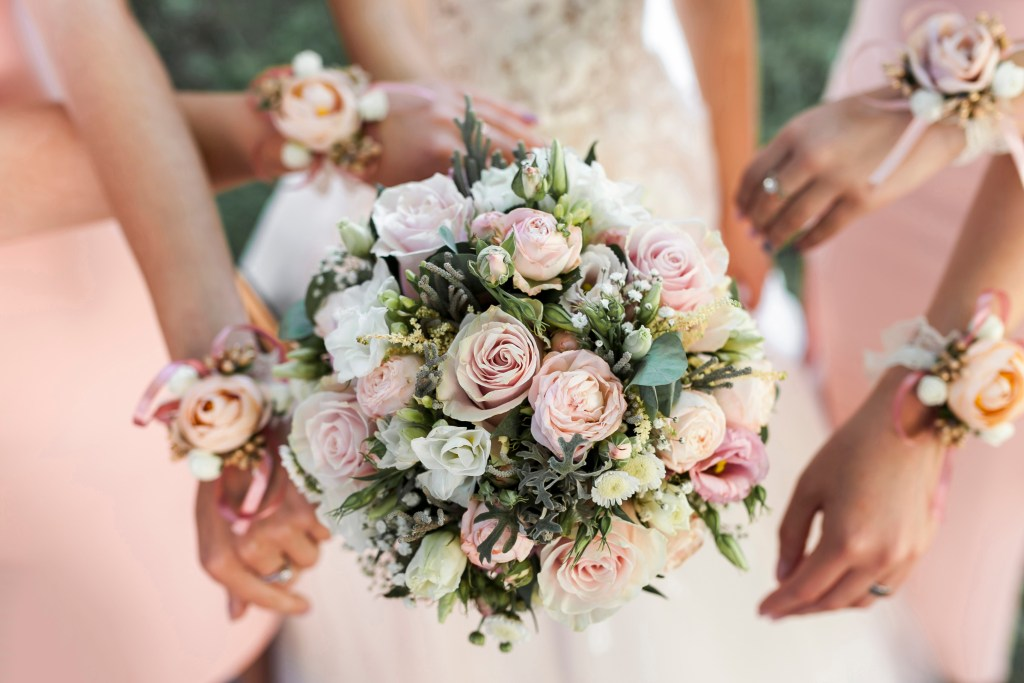 Bride and bridemaids bouquets in blush and white colours with greenery