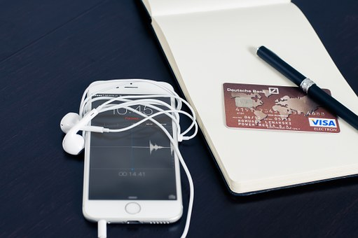 A white mobile phone and a credit card