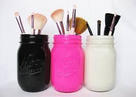 Mason jars and makeup brushes