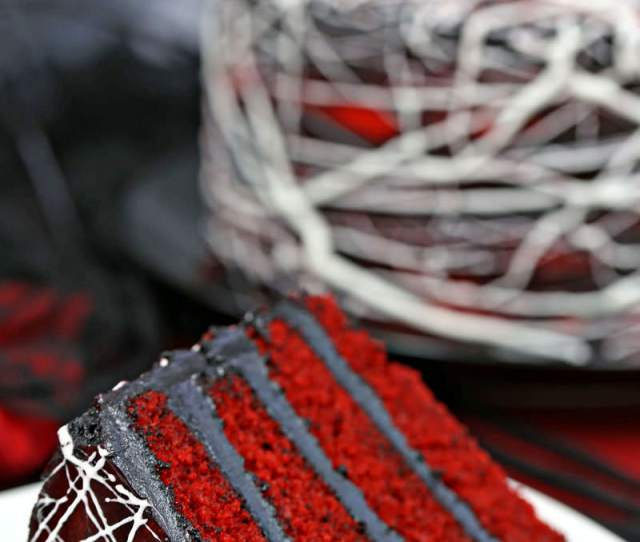 Red Velvet Marshmallow Spiderweb Cake Close Up Of Slice In Foreground With Whole Cake
