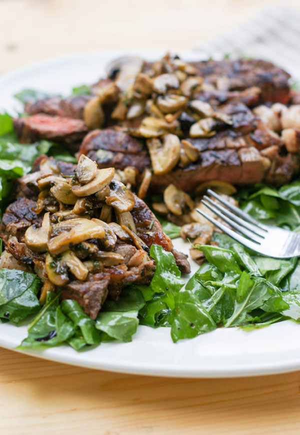 tagliata on a bed of arugula