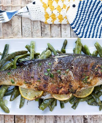 Grilled Branzino stuffed with lemon and herbs