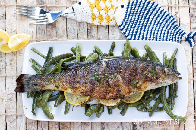 Grilled Branzino stuffed with lemon and herbs