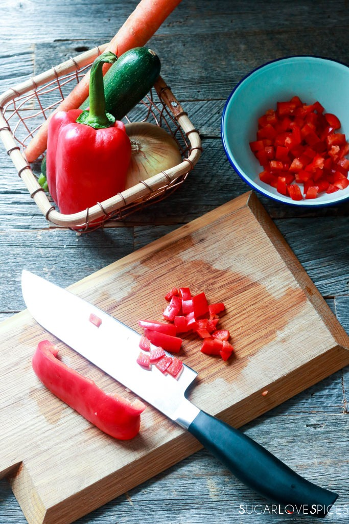 Family Style Loin Roast Dinner-cutting peppers