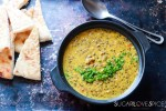Indian-inspired Red Lentil Dahl-dahl in the black pot