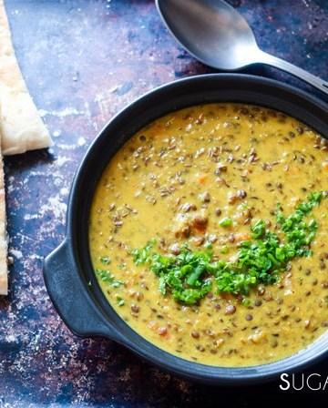 Indian-inspired Red Lentil Dahl-dahl in the black pot