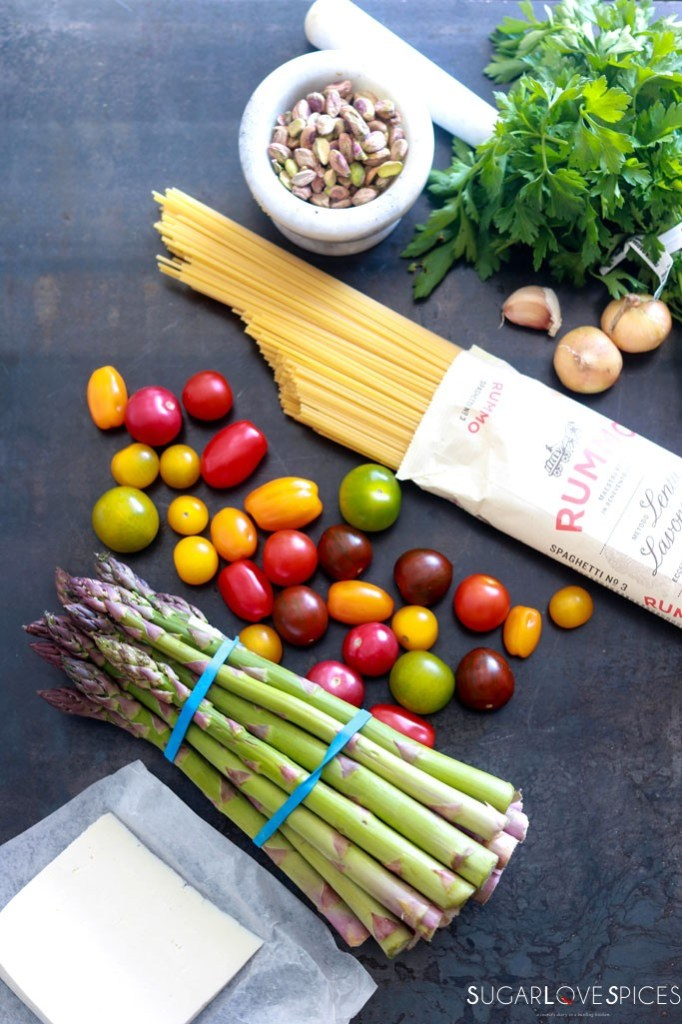 Spaghetti Primavera with Roasted Asparagus and Tomatoes-ingredients on a board