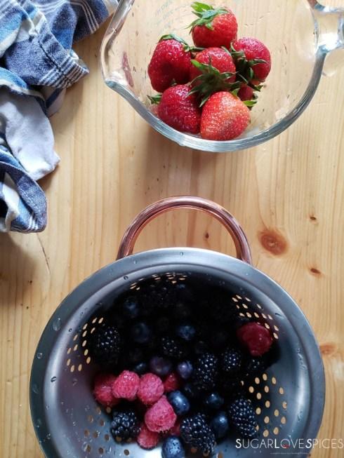 Yogurt Cream Chocolate Ganache Cake with Field Berries-cakes chocolate and cream-field berries in bowls