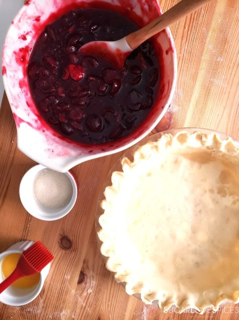 Homemade Cherry Berry Pie-pie bottom in the plate and filing in a bowl